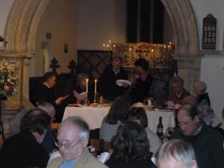 The vicar performs another ritual during the meal