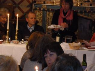 The vicar performs a ritual with the unleavened bread
